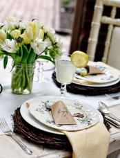 a vintage-inspired place setting with a vine charger, a tulip centerpiece and patterned porcelain