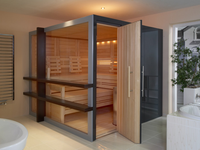 a small steam room clad with natural wood and with some intimate built in lighting for a relaxed ambience and feel
