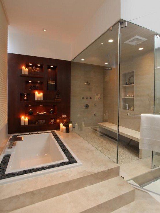 a large neutral steam room with various neutral tiles on the floor and walls, built-in shelves and a bench plus built-in lights and glass walls