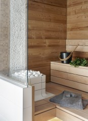 a tiny steam room clad with wood and just a couple of step benches is very welcoming and warming up