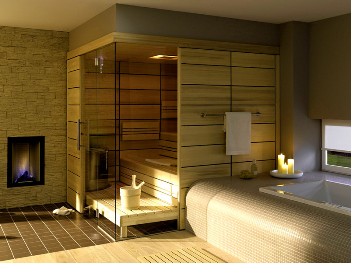a tiny steam room clad with light colored wood, with step benches and some built in lights and a hearth is amazing