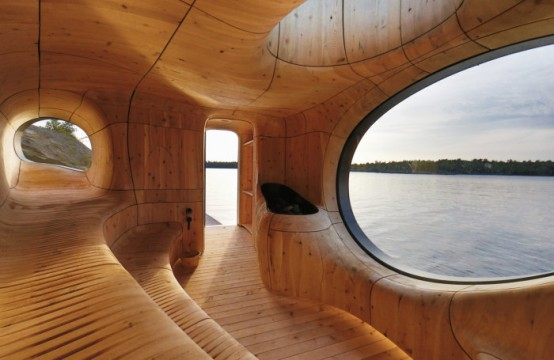 a gorgeous all curved steam room clad with wood, with cavities and several windows and a sew view is an oasis of relaxation