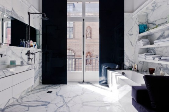 Marble is a great materials to design a luxurious bathroom. Mixed with dark accents you can make such bathroom more manly.