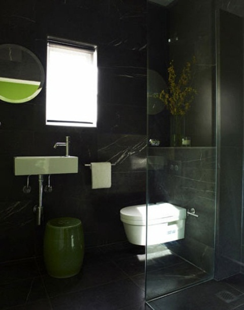 White bathroom appliances looks great on pure black walls.