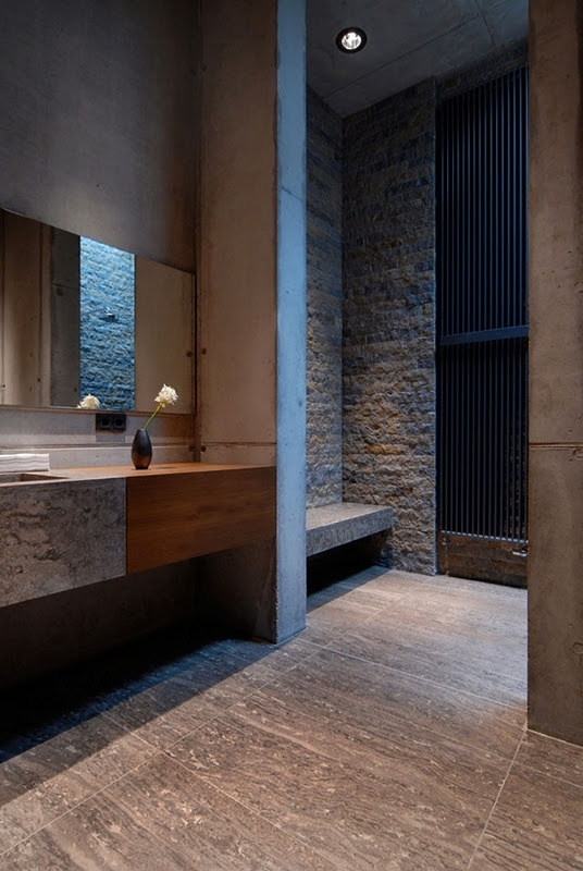 If you like ruggedness then exposed stone is a way to go. For a more contemporary look use tiles imitating it.