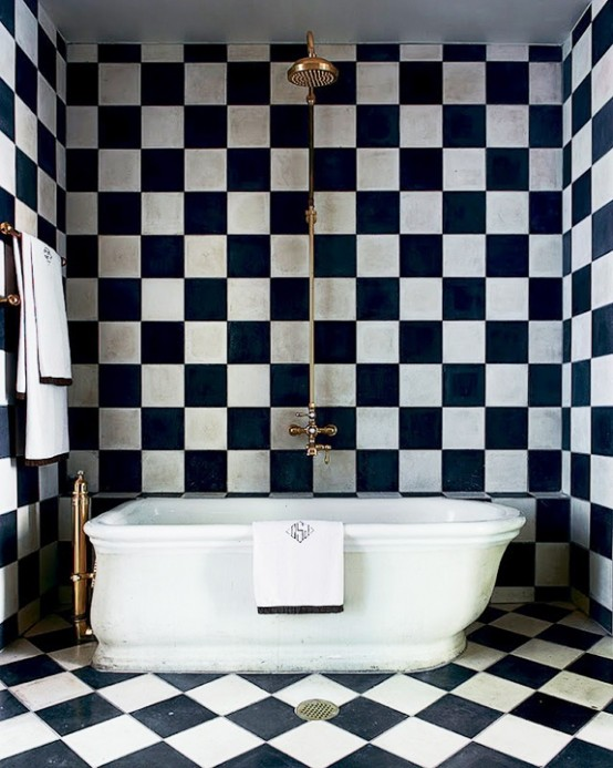 The black and white checkered tiles are responsible for giving this bathroom its personality.