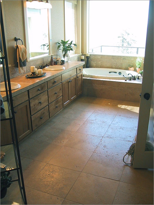 Roughness is always welcomed if you want to make a bathroom more manly. Stone tiles on floors and rough wood cabinets here do the job.