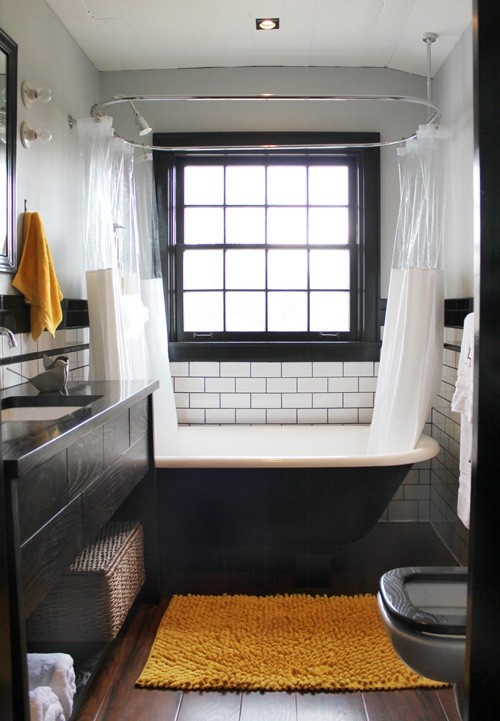 White subway tiles looks great in masculine bathrooms but make sure to mix them with lots of dark elements. That could be vanities, bathroom accessories, bathtubs and even such things as doors and window frames.