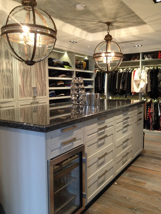 A wine cooler isn't a typical addition to a closet but imagine how fun the process of trying different outfit combinations would be...