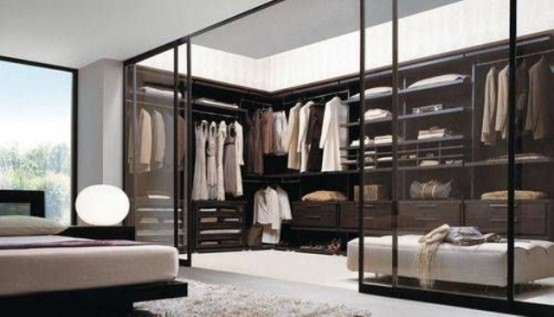If your clothes are gorgeous, why not to organize their showcase right in your bedroom? Transparent glass doors would do the trick.