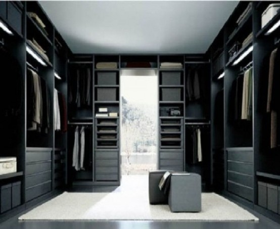 When you have a floor to ceiling window in your walk-in closet you can pull off a dark color scheme without any worries.