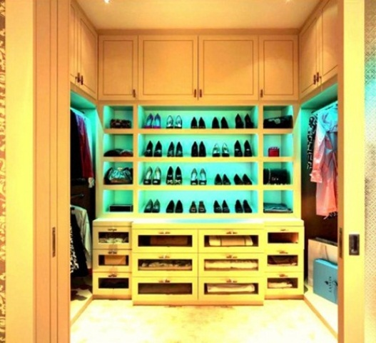 Cool built-in lighting is a great way to perk up your closet.