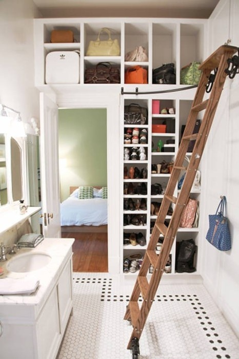 Here is an awesome idea to combine a walk-in closet with a bathroom and use every ounce of space. A ladder will help to access upper cabinets and become a nice piece of decor.