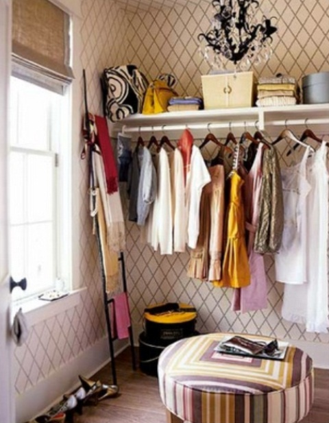 A small wooden ladder could become a great solution to organize your scarves.