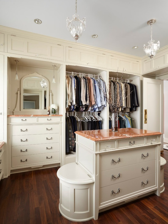 An island in a walk-in closet could provide lots of storage space and become a centerpiece of a room where you could display your accessories or some decor.