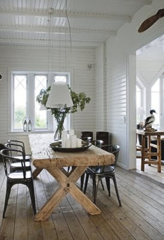 Summer House Decorated With Rough Wooden Furniture