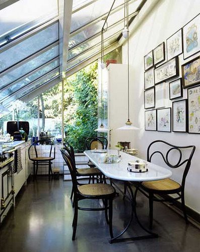 a kitchen with glass roof and floor to ceiling windows is awesome place for cooking - Sunroom Design Ideas