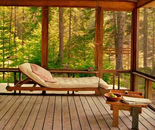Every sunroom should have a cozy daybed. So great place to relax.
