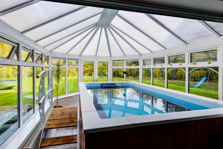 sunroom is a perfect place for an indoor pool