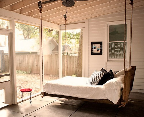 Sunroom-style bedroom. Who said you need some other furniture besides a hanging bed?