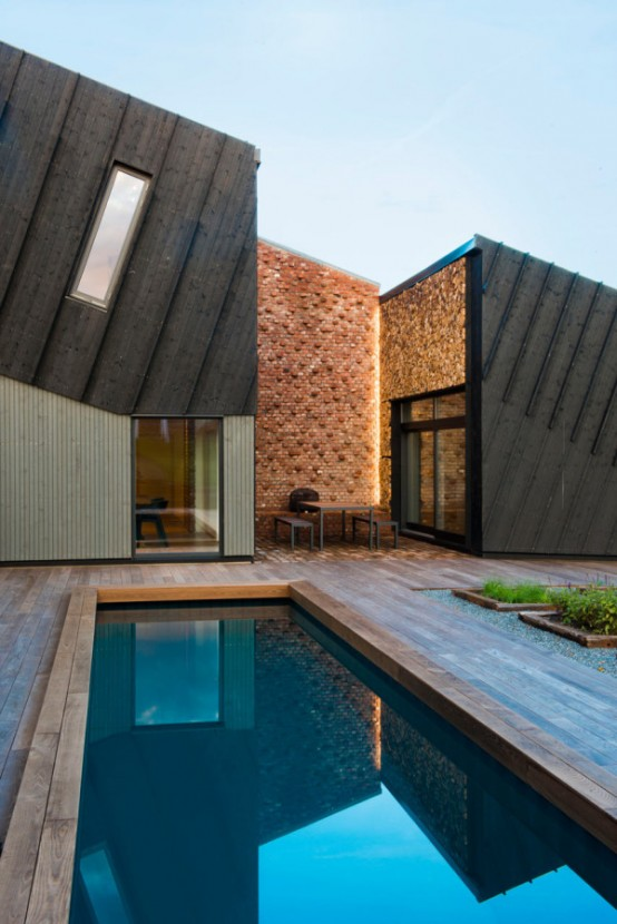 Sustainable Home Design With Solar Panels And Collectors - DigsDigs