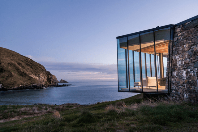Picture Of sustainable oceanfront cabin on volcanic mountainside  1