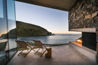 sustainable-oceanfront-cabin-on-volcanic-mountainside-10