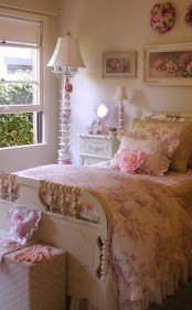 a neutral and pastel shabby chic bedroom with refined neutral furniture, a whimsy teapot lamp, floral artworks and bedding