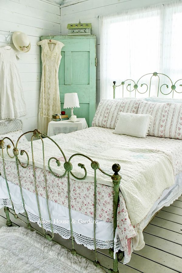 a neutral vintage bedroom with elegant and refined furniture, a mint vintage door in the corner, neutral linens