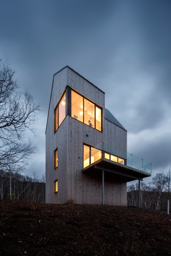 The cabin resembles a wooden tower ruling the location