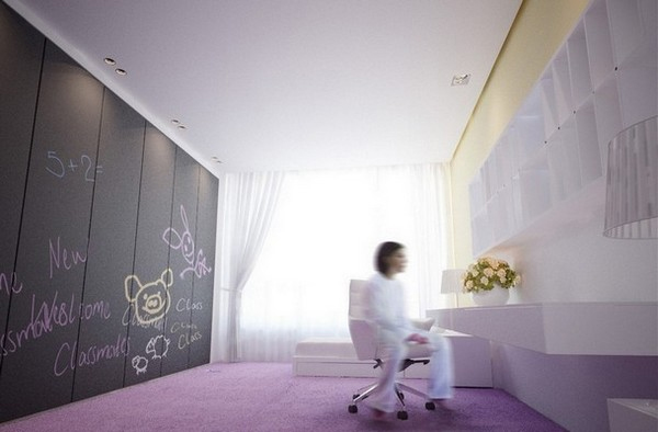 a pastel teen bedroom with a yellow wall, a lilac floor, a whole wall taken by a storage unit covered with chalkboard