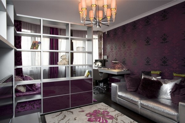 a dark purple and silver teen bedroom, a printed purple wall, a mirror sliding door wardrobe, a floral rug and a retro chandelier