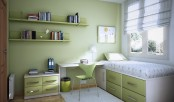 a pretty green teen room with a light green wall, some cabinets, a desk and a bed with drawers plus wall-mounted shelves