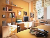 an orange teen room with orange and striped walls, some wall-mounted shelves, a cabinet, a corner desk and a bed with storage