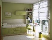 a green teen room with green walls, a large window that takes the whole wall, a bed with storage, some shelves and a desk by the window