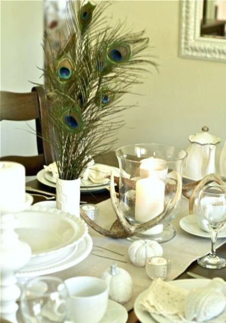 white porcelain, linens, pumpkins and candles plus antlers make up a chic and stylish Thanksgiving tablescape in neutrals