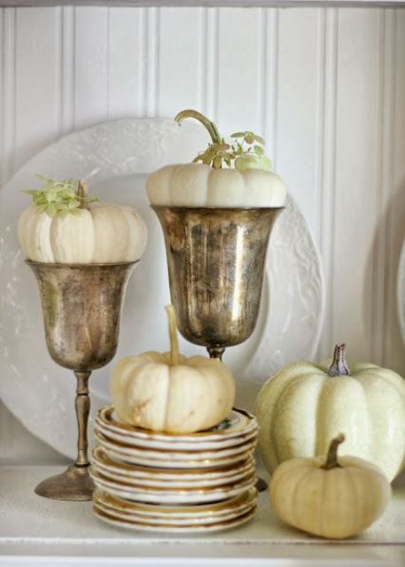 white pumpkins in plates and in goblets are adorable for simple and chic fall or Thanksgiving decor