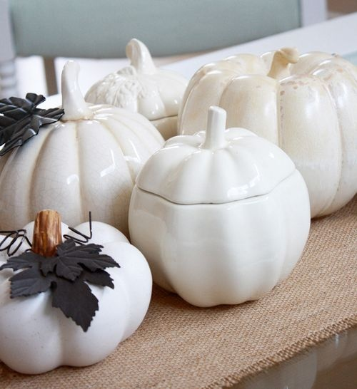 white porcelain pumpkins and white pumpkins for decor with dark leaves will make your space chic and vintage-inspired