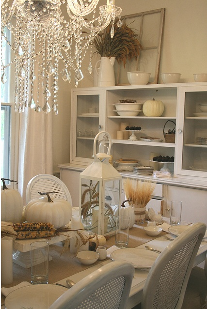 a sweet white Thanksgiving tablescape with white pumpkins, gourds, white porcelain, candles and wheat and corn cobs is amazing