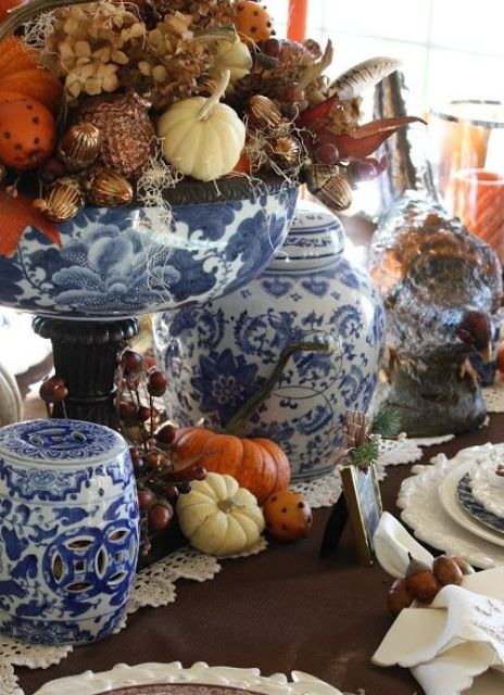 fantastic blue and white porcelain - vases and jars wiht lids are great for sprucing up your fall-colored tablescape and making it unusual