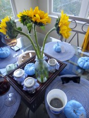 light blue pumpkins and blue textile placemats can be used to spruce up your modern Thanksgiving tablescape