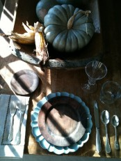 blue pumpkins and chargers add a refreshing touch to this rustic Thanksgiving tablescape