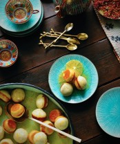 spruce up your traditionally fall-colored table setting with turquoise plates and chargers for a fresh look