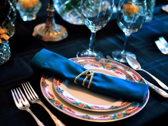 a teal tablecloth and napkins will give your Thanksgiving tablescape a non-traditional and fresh look