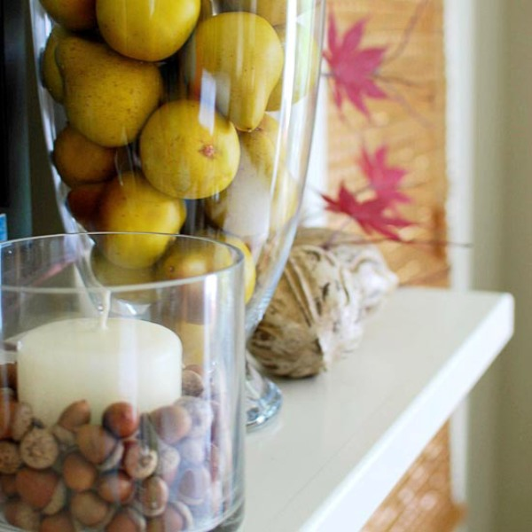 glasses with acorns and pears, twine balls and fall leaves will help you to create a lovely and all natural Thanksgiving mantel