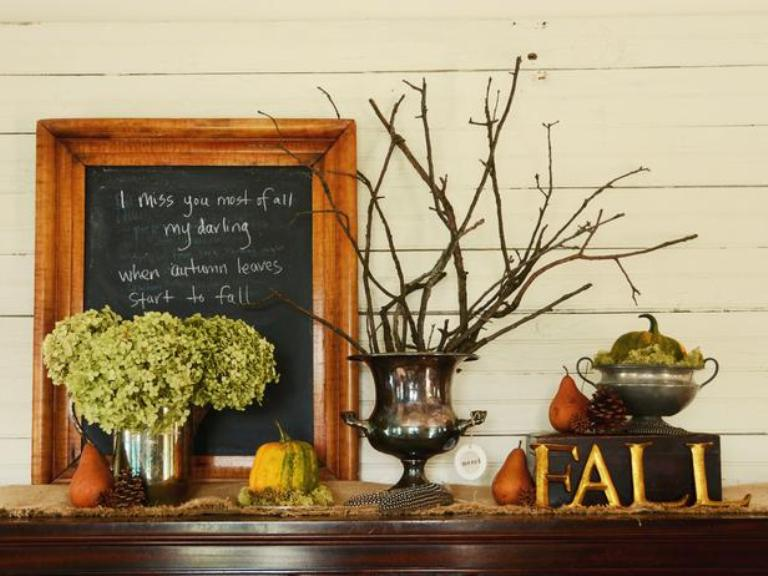 a fall and Thanksgiving mantel with green hydrangeas, branches, a chalkboard sign, a pumpkin in a sugar pot and pears and pinecones