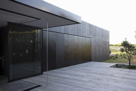 The House That Consists Of Two Habitable Areas Connected By Floating Pavilion