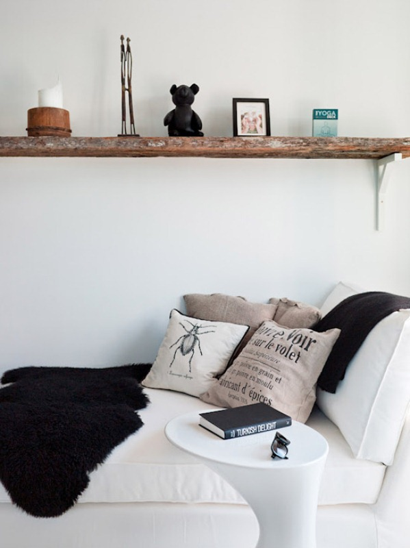 Tiny Black And White Studio With Wood Accents
