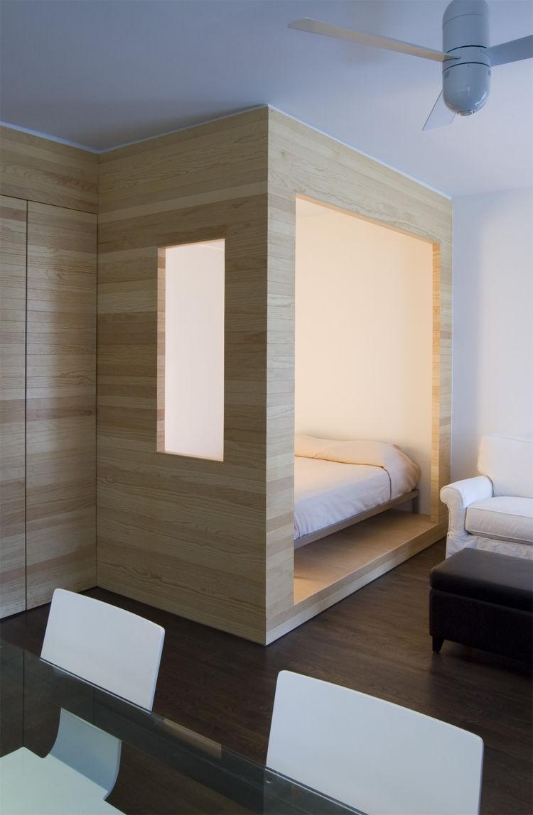 Tiny Studio Organized With A Smart Storage Wall