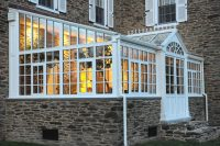 traditional conservatory design with a glass roof